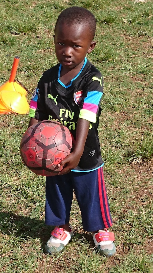 A young Kampala Galaxy Soccer Academy player