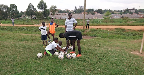 Kampala Galaxy Soccer Academy coaches and players